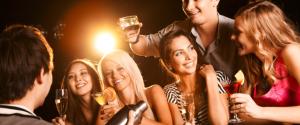 people at a bar drinking hooch