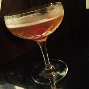 Halloween drink called the Widow's kiss shown in a martini glass