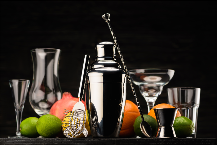 must have bar tools like shaker, spoon, strainer, some assorted citrus and glass for cocktails